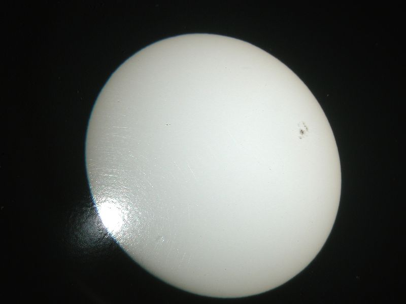 I held a simple digital camera to the projection screen to take these pictures. Since it is almost impossible to be right on top of the subject the image looks slightly oblong and not round. Some flare is visible due to the cameras angle.