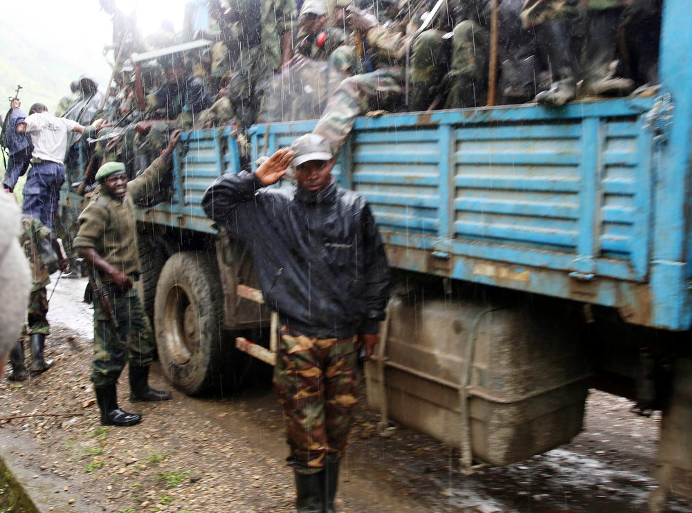 . M23 rebel fighters sit in a truck as they withdraw near the town of Sake, some 42 km (26 miles) west of Goma November 30, 2012. A rebel pullback from Goma, seized by M23 from fleeing United Nations-backed government forces on November 20, would signal some progress in international efforts to halt the eight-month-old insurgency in eastern Democratic Republic of Congo. REUTERS/Goran Tomasevic