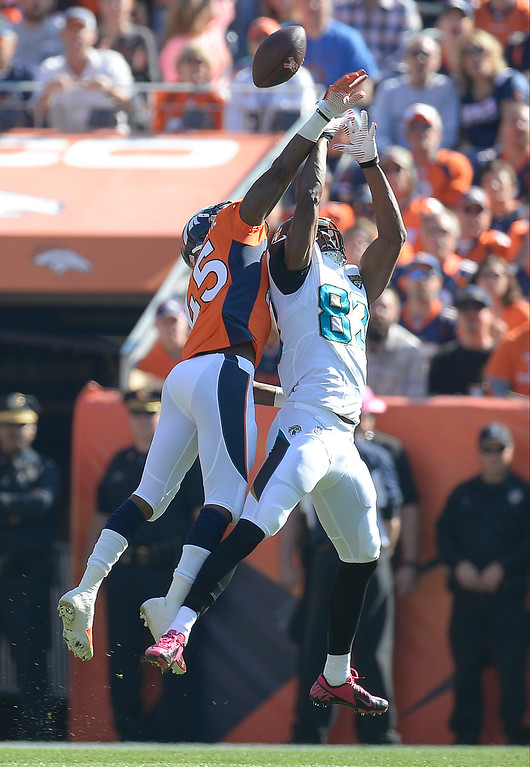 . Denver Broncos cornerback Dominique Rodgers-Cromartie (45) breaks up a pass to Jacksonville Jaguars wide receiver Stephen Williams (83) in the first quarter.   (Photo by John Leyba/The Denver Post)
