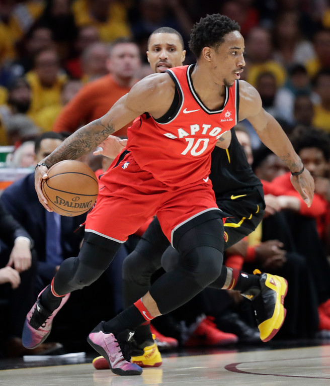 . Toronto Raptors\' DeMar DeRozan (10) drives away from Cleveland Cavaliers\' George Hill in the first half of Game 4 of an NBA basketball second-round playoff series, Monday, May 7, 2018, in Cleveland. (AP Photo/Tony Dejak)