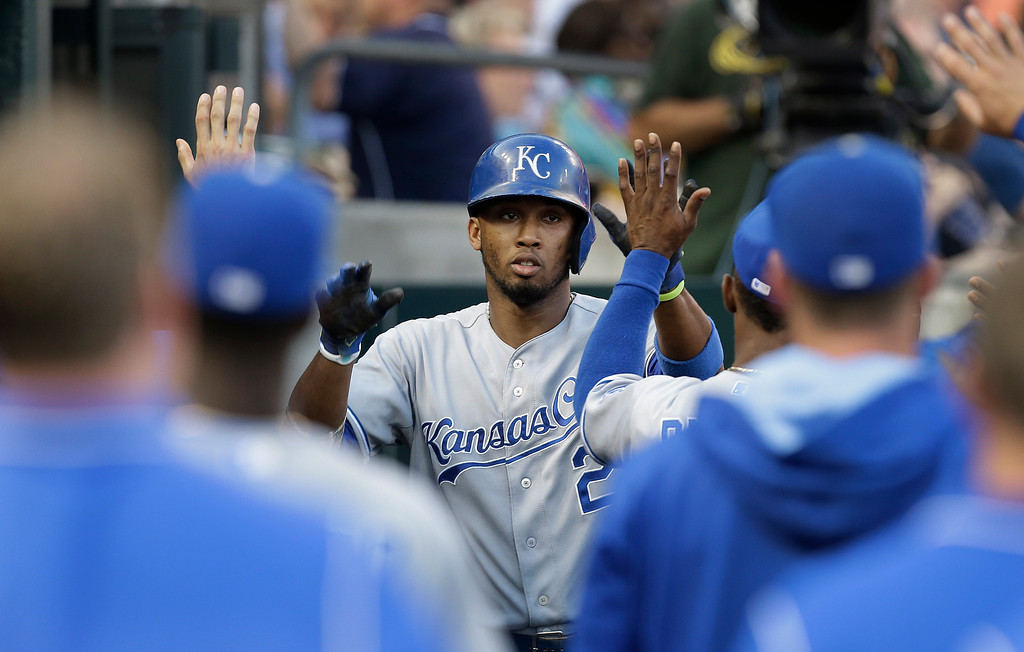 . Kansas City Royals\' Alcides Escobar (2) celebrates with teammates after scoring on a Omar Infante single against the Detroit Tigers in the fifth inning of a baseball game in Detroit, Monday, June 16, 2014.  (AP Photo/Paul Sancya)