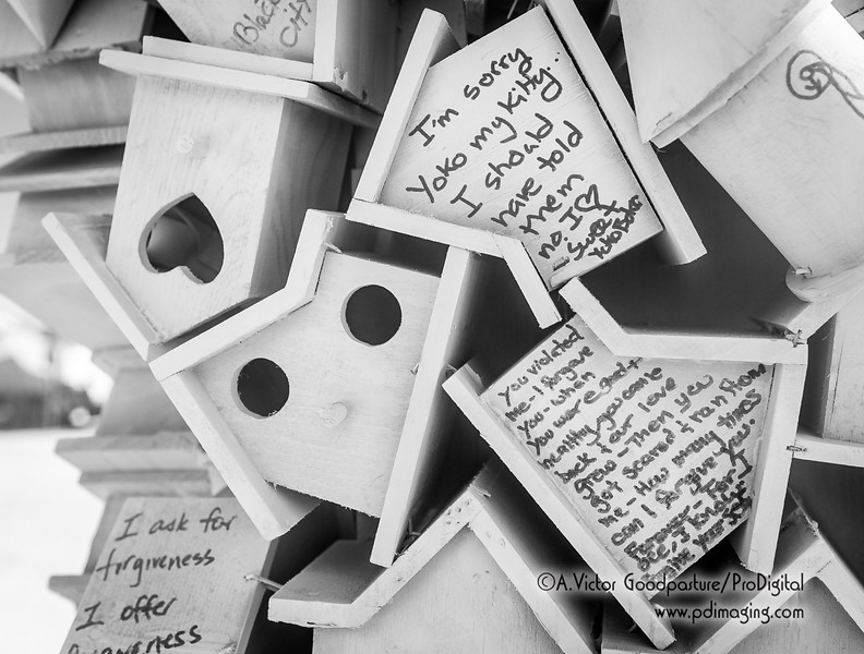 """Visitors were asked to write a message to forgive someone or ask for forgiveness and then place it on or in the birdhouses. Later in the week, the birdhouses would be burned to """"bring absolution."""""""