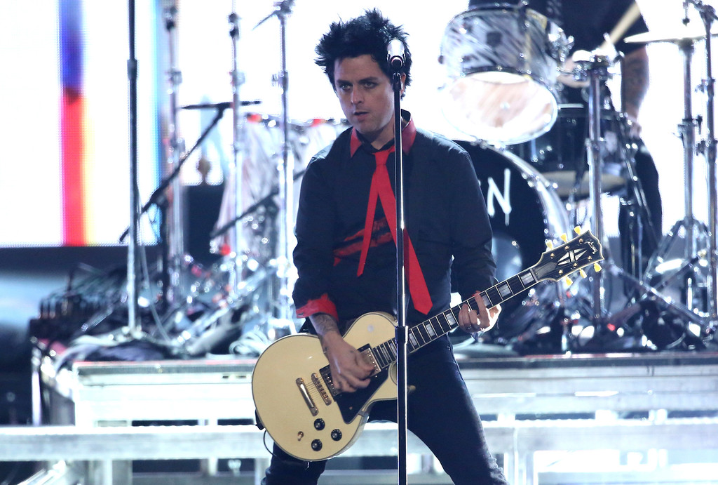 ". Billie Joe Armstrong, of Green Day, performs ""Bang Bang\"" at the American Music Awards at the Microsoft Theater on Sunday, Nov. 20, 2016, in Los Angeles. (Photo by Matt Sayles/Invision/AP)"