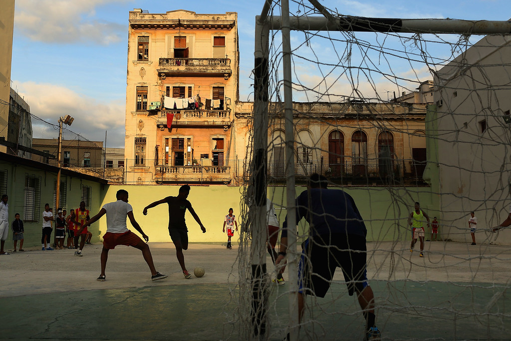 . Young men play soccer on the concrete court at the Camilo Cienfuegos Sports Center January 25, 2015 in Havana, Cuba. Diplomats from the United States and Cuba held historic talks this week that could restore diplomatic ties and mark the end of more than 50 years of of Cold War-era hostility between the two countries.  (Photo by Chip Somodevilla/Getty Images)