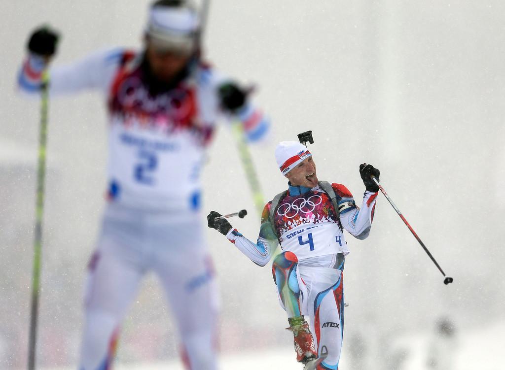 . The Czech Republic\'s Ondrej Moravec, right, celebrates winning the bronze medal next to silver medalist France\'s Martin Fourcade, during the men\'s biathlon 15k mass-start, at the 2014 Winter Olympics, Tuesday, Feb. 18, 2014, in Krasnaya Polyana, Russia. (AP Photo/Felipe Dana)