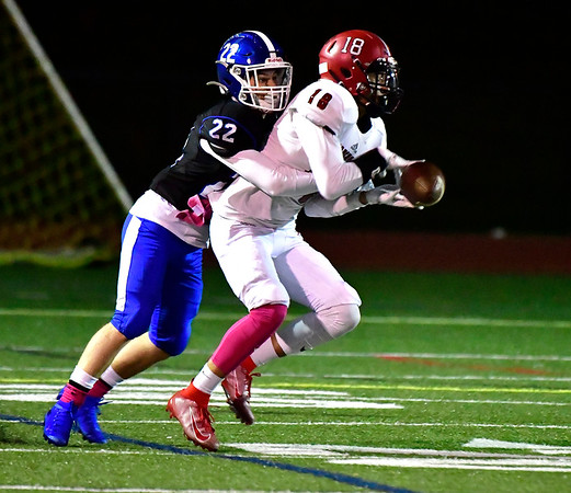 10/11/2019 Mike Orazzi | StaffrSouthington's Weston Brick (22) and Machester Jamil Gonzalez (18) during Friday night's football game in Southington. rr
