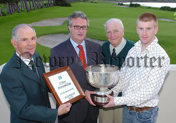 Gerry O Keeffe  of AIB  Clanbrassil street DUndalk Sponsors of the  O Hare Memorial Cup  presenting DAmien White of Greenore GC  with it after Sunday,s tournament in Greenore GC with from left Ciaran McGooey CAptain of Greenore GC and Eric Hynes of the organising committee   (AK)