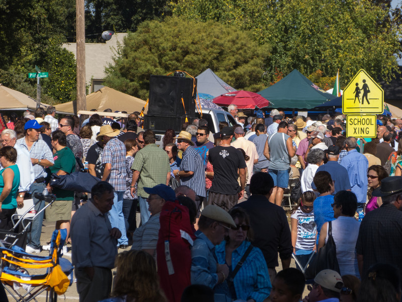 """Huge crowds headed to lunch at the Annual Portuguese """"Our Lady of Fatima"""" Celebration parade in Thorton, CA."""