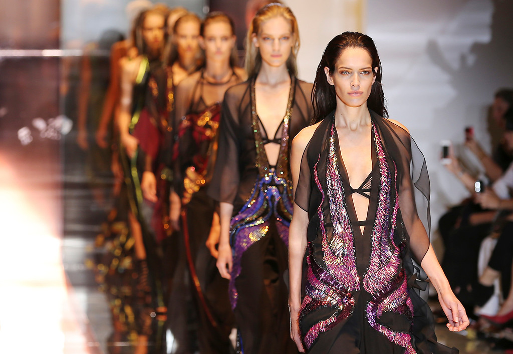 . Models wear creations for Gucci women\'s Spring-Summer 2014 collection, part of the Milan Fashion Week, unveiled in Milan, Italy, Wednesday, Sept. 18, 2013. (AP Photo/Antonio Calanni)