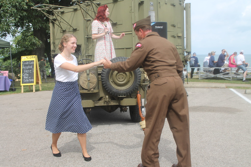 . Jennelle Gilreath, St. Louis,  Missouri sings big band hits of the 1940s while Luke Sharrett, Louisville Kentucky, dances with Alicia Williams of Norton.  Both Gilreath and Sharrett perform as solo reenactors representing the USO during D-Day Conneaut on Aug. 17. Kristi Garabrandt - The News-Herald
