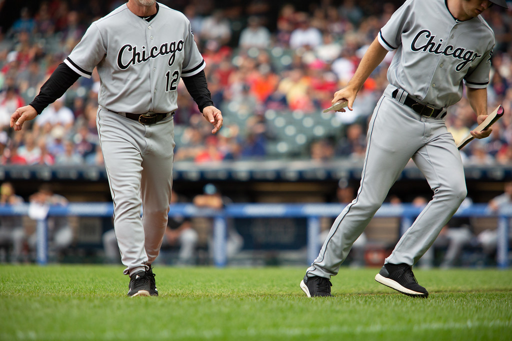 . Chicago White Sox bat boys carry off a broken bat during during a regular season game at Progressive Field on June 20, 2018. The Indians defeated the Sox 12-0. (The Morning Journal/Michael Johnson)