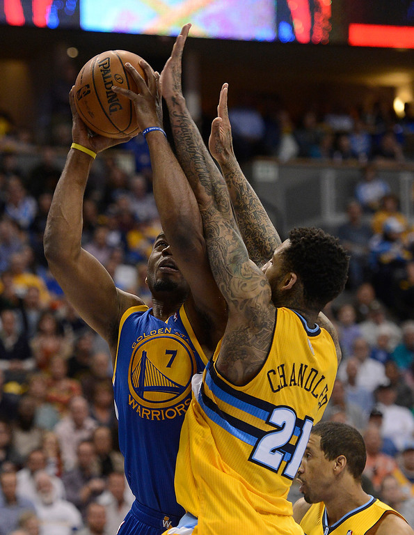 . DENVER, CO. - APRIL 20: Golden State Warriors power forward Carl Landry (7) tries to put up a shot while he is guarded by Denver Nuggets shooting guard Wilson Chandler (21) in the fourth quarter. The Denver Nuggets took on the Golden State Warriors in Game 1 of the Western Conference First Round Series at the Pepsi Center in Denver, Colo. on April 20, 2013. (Photo by John Leyba/The Denver Post)