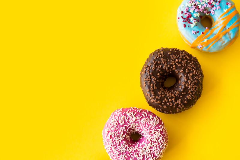 yummy-donuts-on-yellow-background-picjumbo-com.jpg