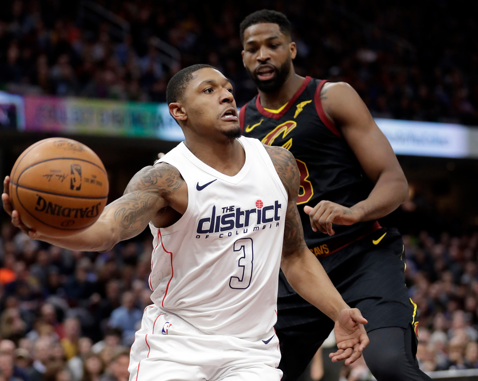 . Washington Wizards\' Bradley Beal (3) drives past Cleveland Cavaliers\' Tristan Thompson (13) in the second half of an NBA basketball game, Thursday, April 5, 2018, in Cleveland. (AP Photo/Tony Dejak)