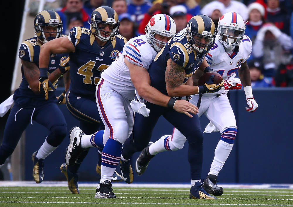 . James Laurinaitis #55 of the St. Louis Rams picks up a fumble during an NFL game as he is tackled by David Snow #61 of the Buffalo Bills after teh Bills turned the ball over at Ralph Wilson Stadium on December 9, 2012 in Orchard Park, New York. (Photo by Tom Szczerbowski/Getty Images)