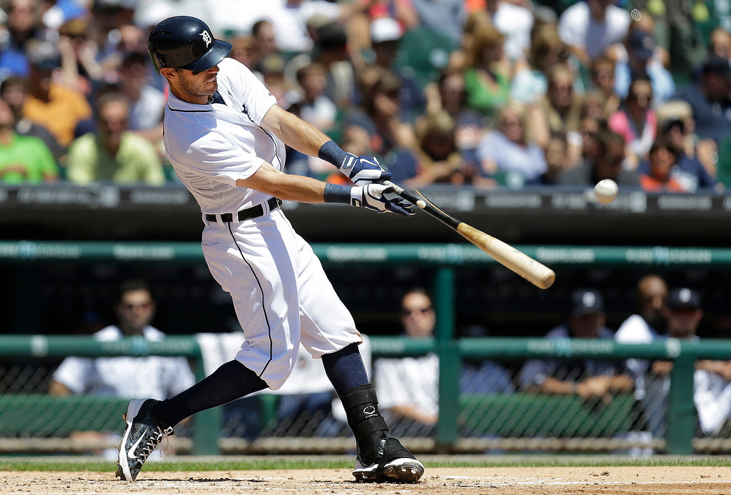 . Detroit Tigers\' Ian Kinsler hits a one-run triple against the Toronto Blue Jays in the third inning of a baseball game in Detroit, Thursday, June 5, 2014. (AP Photo/Paul Sancya)