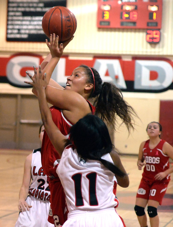 . Workman\'s Alize Williams drives to the basket past Gladstone\'s Tiara Rice (11) in the first half of a prep basketball game at Gladstone High School in Covina, Calif., on Friday, Jan. 17, 2014. (Keith Birmingham Pasadena Star-News)