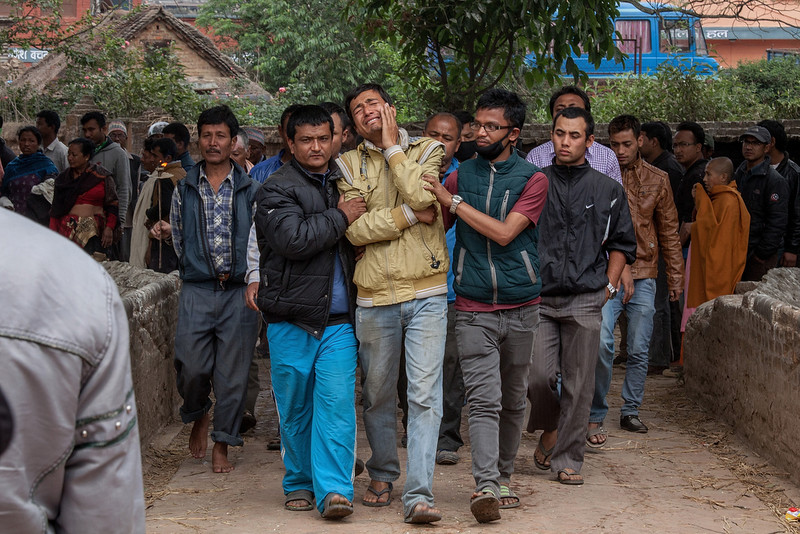 . Relatives of a victim of the earthquake that hit Nepal yesterday cry while walking to the cremation site on April 26, 2015 in Bhaktapur, Nepal. A major 7.8 earthquake hit Kathmandu mid-day on Saturday, and was followed by multiple aftershocks that triggered avalanches on Mt. Everest that buried mountain climbers in their base camps. Many houses, buildings and temples in the capital were destroyed during the earthquake, leaving thousands dead or trapped under the debris as emergency rescue workers attempt to clear debris and find survivors.  (Photo by Omar Havana/Getty Images)
