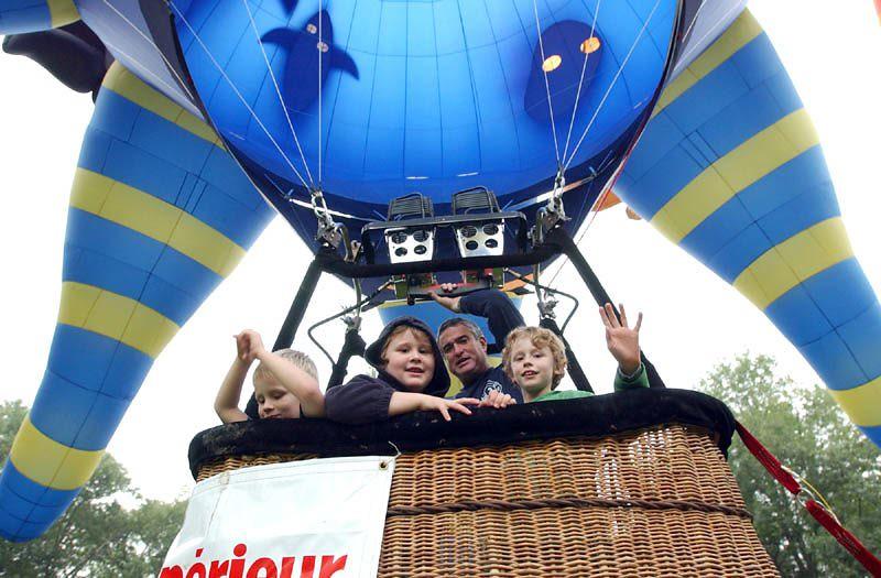 Russ Dillingham/Sun Journal Great Falls Balloon Festival Friday morning launch