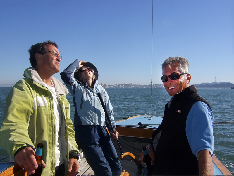 "Left, Marc Lambros; Center, Joan Wheeler, lady friend of Ron Young; Right, Ron Young - Sailing on San Francisco Bay on Ron Young's classic wooden boat ""Youngster"""