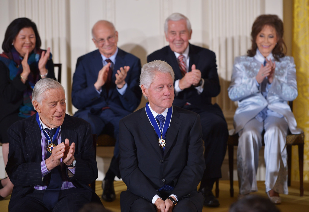 . Former US president Bill Clinton (C) is applauded after receiving the Presidential Medal of Freedom during a ceremony in the East Room of the White House on November 20, 2013 in Washington, DC.  AFP PHOTO/Mandel NGAN/AFP/Getty Images