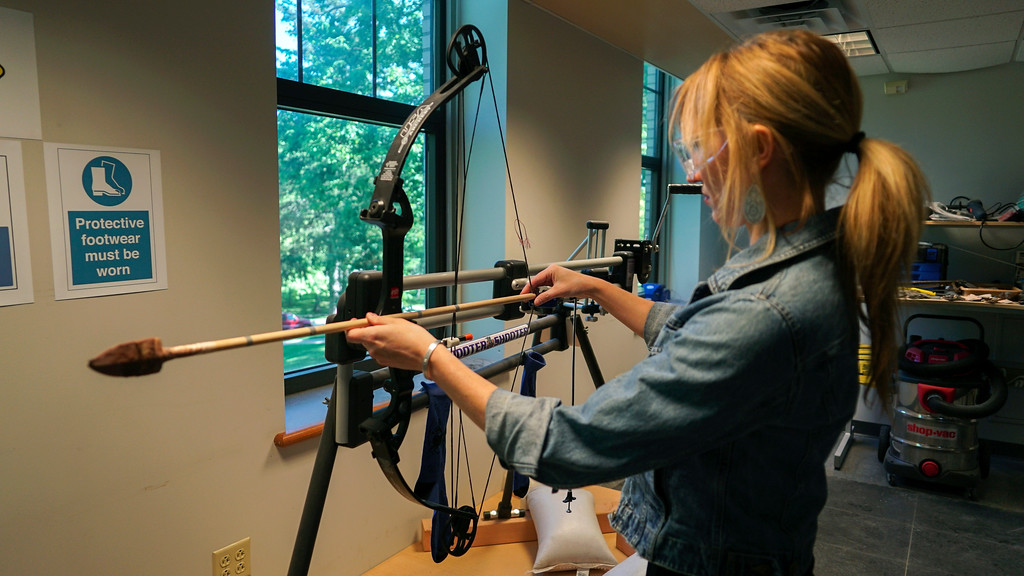 . In this June 1, 2017, photo, Michelle Bebber, a PhD archeology student at Kent State University, loads a bow with a recreated ancient arrow in Kent, Ohio. Bebber conducts research at a newly-opened laboratory which makes replicas of ancient arrows, knives, and pottery to be shot, crushed, and smashed. It\'s allowing researchers to learn about engineering techniques of the first native Americans without destroying priceless genuine relics in the process. (AP Photo/Dake Kang)