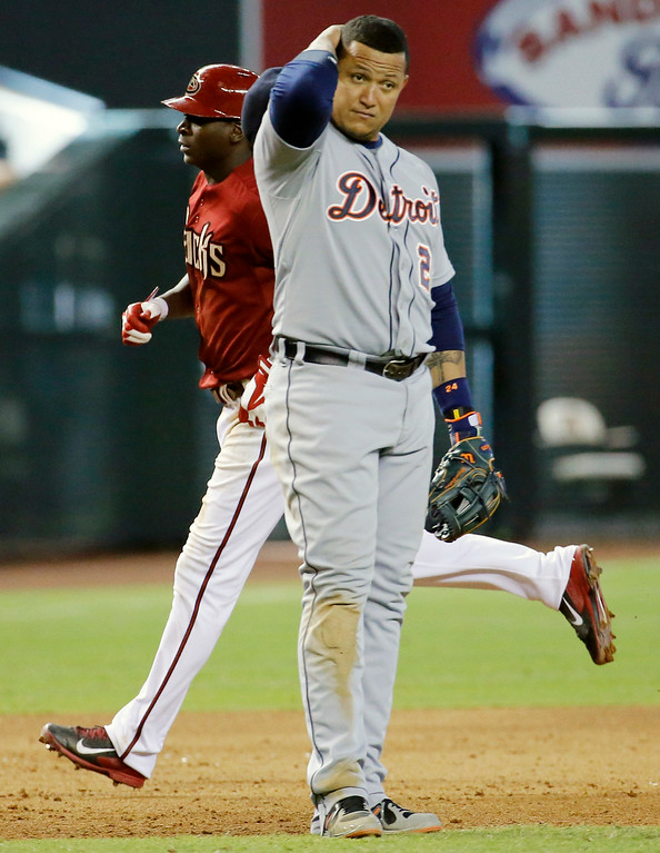 . Detroit Tigers\' Miguel Cabrera, front, looks to his bench as Arizona Diamondbacks\' Didi Gregorius rounds the base after hitting a two run home run during the fifth inning of a baseball game, Wednesday, July 23, 2014, in Phoenix. (AP Photo/Matt York)