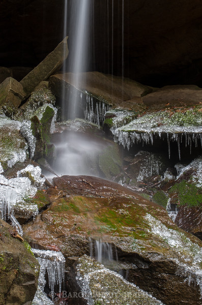 Narrow Flow of Eckert Falls on Icy Rocks