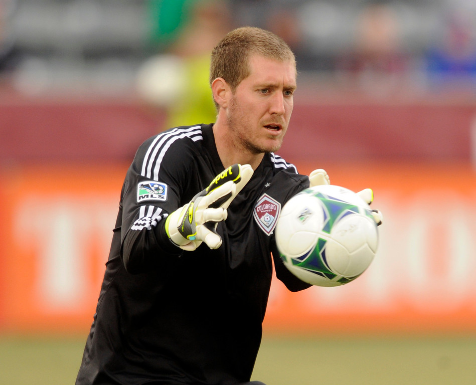 . Clint Irwin (31) of the Colorado Rapids wrapped up the ball in the first half. The Colorado Rapids hosted the Portland Timbers Saturday, March 30, 2013 at Dick\'s Sporting Goods Park in Commerce City.  Photo By Karl Gehring/The Denver Post)