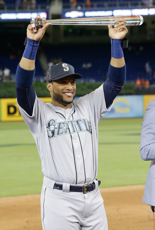 . American League\'s Seattle Mariners Robinson Cano (22), lifts the MLB All-Star MVP trophy, Tuesday, July 11, 2017, in Miami. Cano hit the game winning home run in the tenth inning. The American League defeated the National League 2-1. (AP Photo/Lynne Sladky)