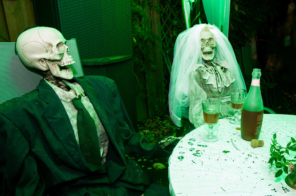 . Two skeletons dressed for a wedding sit in a garden of the Horn family house in Isernhagen, Germany, on October 28, 2013. The Horn family has been decorating their house for Halloween for more than ten years.  CHRISTIAN DITTRICH/AFP/Getty Images