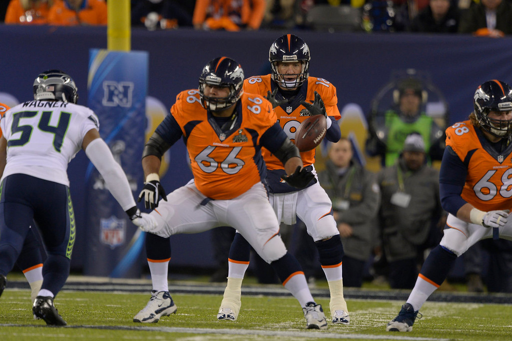 . Denver Broncos quarterback Peyton Manning (18) takes the snap during the first quarter. The Denver Broncos vs the Seattle Seahawks in Super Bowl XLVIII at MetLife Stadium in East Rutherford, New Jersey Sunday, February 2, 2014. (Photo by John Leyba/The Denver Post)