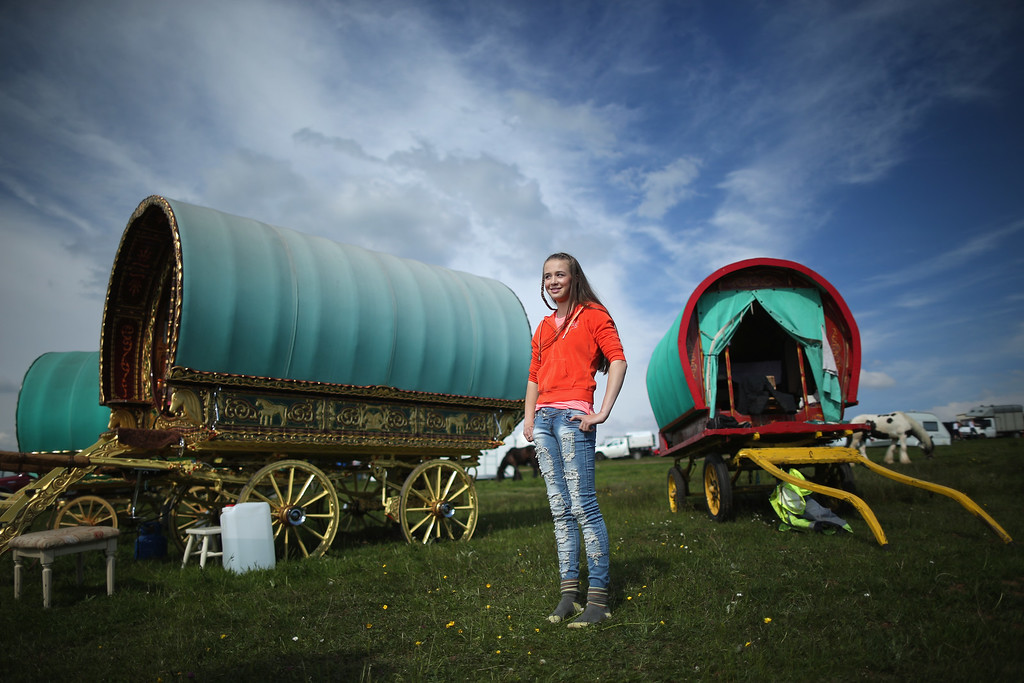 . Young traveller Loren Gaskin, aged 15, looks out over Fair Hill during the Appleby Horse Fair on June 4, 2015 in Appleby, England. The Appleby Horse Fair has existed under the protection of a charter granted by James II since 1685 and is one of the key gathering points for the Romany, gypsy and traveling community. The fair is attended by about 5,000 travelers who come to buy and sell horses. The animals are washed and groomed before being ridden at high speed along the \'mad mile\' for the viewing of potential buyers.  (Photo by Christopher Furlong/Getty Images)