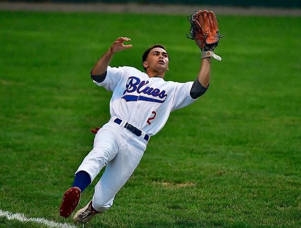 8/8/2019 Mike Orazzi | Staff The Bristol Blues' Christian Beal (2) makes a diving catch in left field during Thursday evenings playoff game with the North Shore Navigators at Muzzy Field in Bristol.