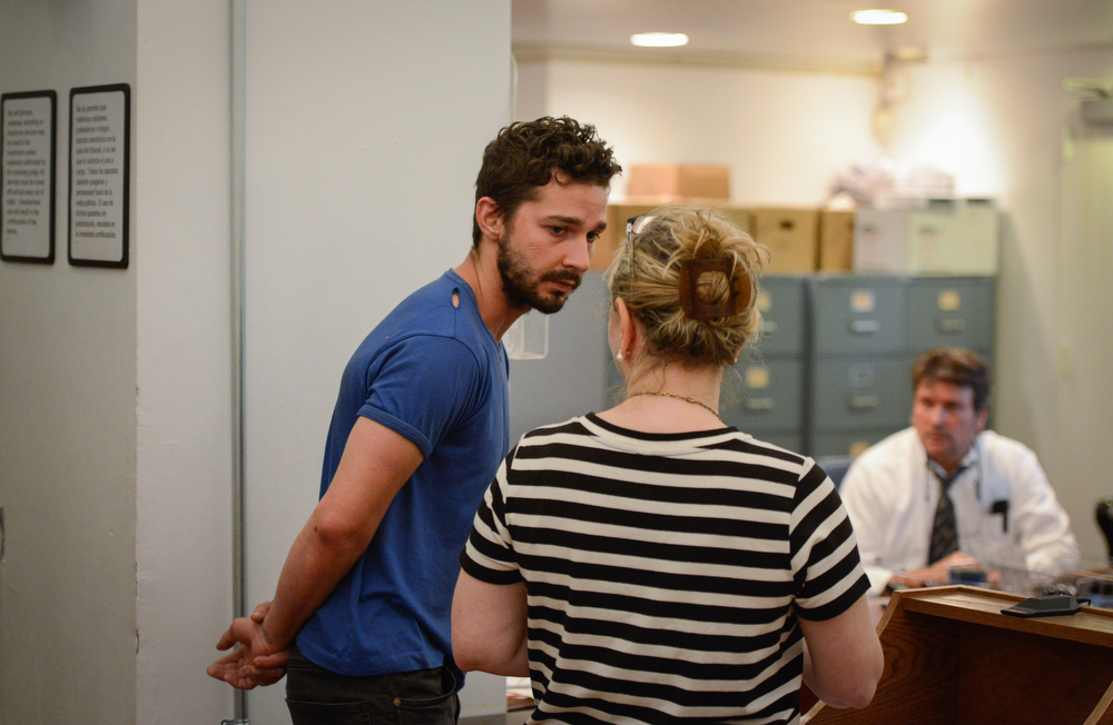 . Shia LaBeouf, left, represented by a Legal Aid attorney, is arraigned in Midtown Community Court, in New York, Friday, June 27, 2014. LaBeouf was released from police custody Friday after he was escorted from a Broadway theater for yelling obscenities and continued to act irrationally while being arrested, authorities said. He\'s due back in court July 24.  (AP Photo/Anthony DelMundo, NY Daily News, Pool)