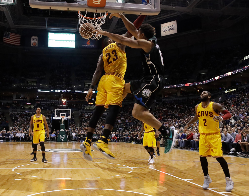 . Milwaukee Bucks\' Malcolm Brogdon dunks over Cleveland Cavaliers\' LeBron James during the second half of an NBA basketball game Tuesday, Dec. 20, 2016, in Milwaukee. (AP Photo/Morry Gash)