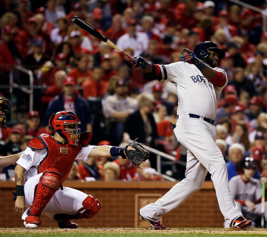 . Boston Red Sox\'s David Ortiz hits a single during the fourth inning of Game 5 of baseball\'s World Series against the St. Louis Cardinals Monday, Oct. 28, 2013, in St. Louis. (AP Photo/Jeff Roberson)