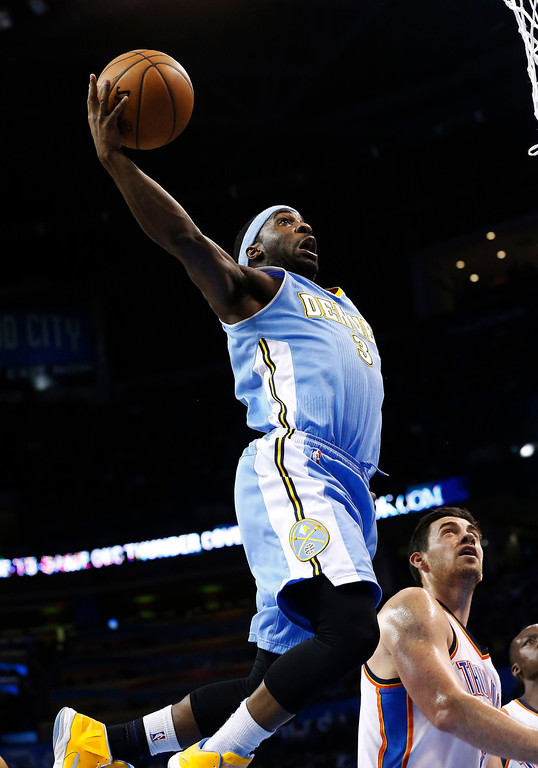 . Denver Nuggets guard Ty Lawson (3) shoots in front of Oklahoma City Thunder forward Nick Collison (4) in the second quarter of an NBA basketball game in Oklahoma City, Tuesday, March 19, 2013. (AP Photo/Sue Ogrocki)