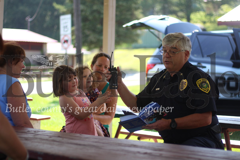 Zelienople Police Chief Miller sat down with area children at the community park Tuesday afternoon to teach them about the importance of police and what officers do to keep them safe.Miller read children's books explaining the role officers play in towns across America and ran through the equipment officers use from handcuffs and radios to police cruisers and soon body cams.Children asked him questions about police work and had the chance to tour a borough police cruiser. Each got their very own police badge sticker and coloring sheet. (photos by Caleb Harshberger)