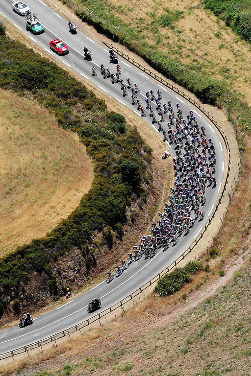 . An aerial view shows the pack of riders as they cycle through the countryside during the 145,5 km third stage of the centenary Tour de France cycling race from Ajaccio to Calvi, on the French Mediterranean island of Corsica July 1, 2013. REUTERS/Pascal Pochard-Casabianca/Pool