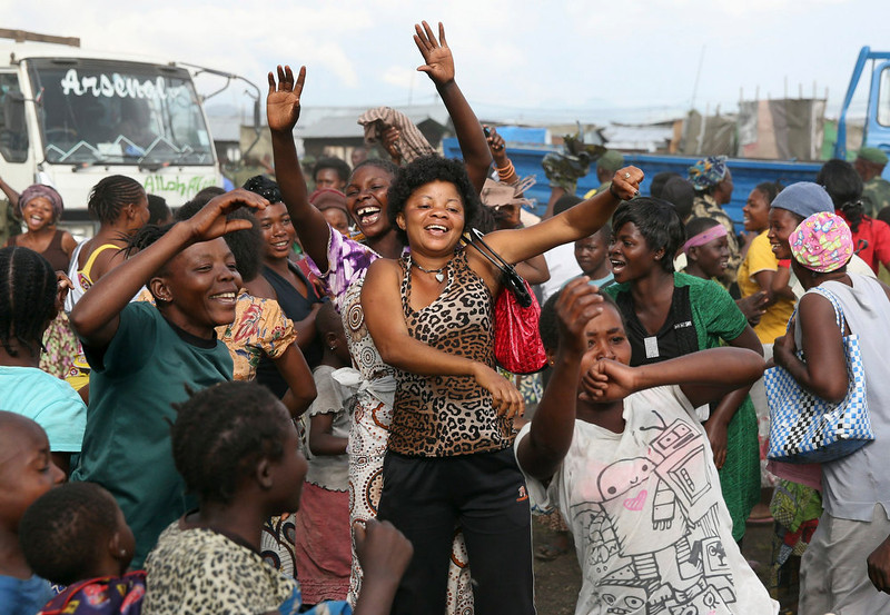 . People dance to celebrate government army FARDC soldiers return to Goma December 3, 2012. REUTERS/Goran Tomasevic