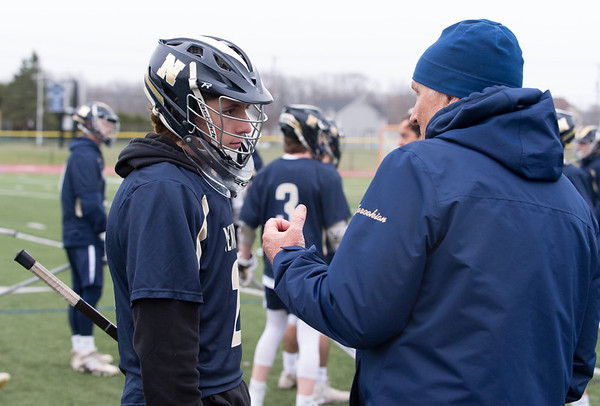 04/08/19 Wesley Bunnell | Staff Southington boys lacrosse vs Newington on Monday evening at Southington High School. Sam Davis (2) speaks with the Newington coach just before the 2nd half.