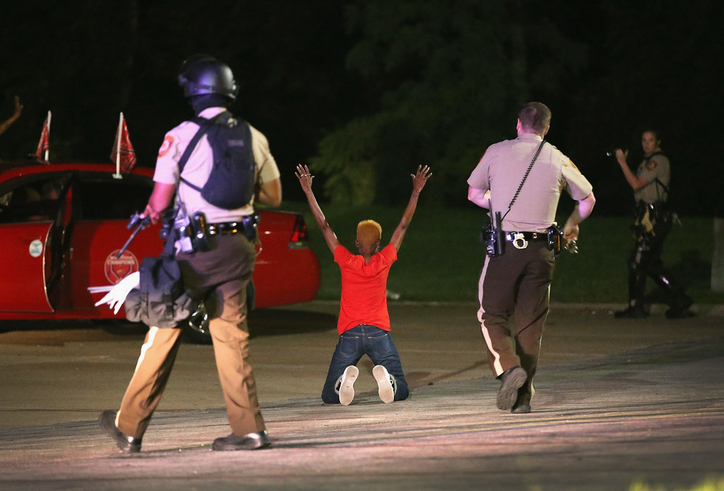 . Police surround and detain two people in a car on August 13, 2014 in Ferguson, Missouri.  (Photo by Scott Olson/Getty Images)