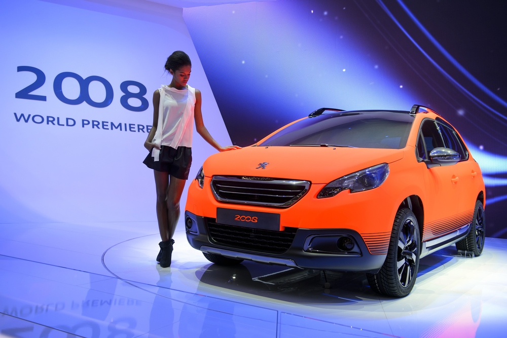 . The new Peugeot 2008 is displayed as World premiere at French car maker\'s booth during the 83rd Geneva Motor Show on March 5, 2013. The Geneva International Motor Show opens its doors under a dark cloud, with no sign of a speedy rebound in sight for the troubled European market.    FABRICE COFFRINI/AFP/Getty Images