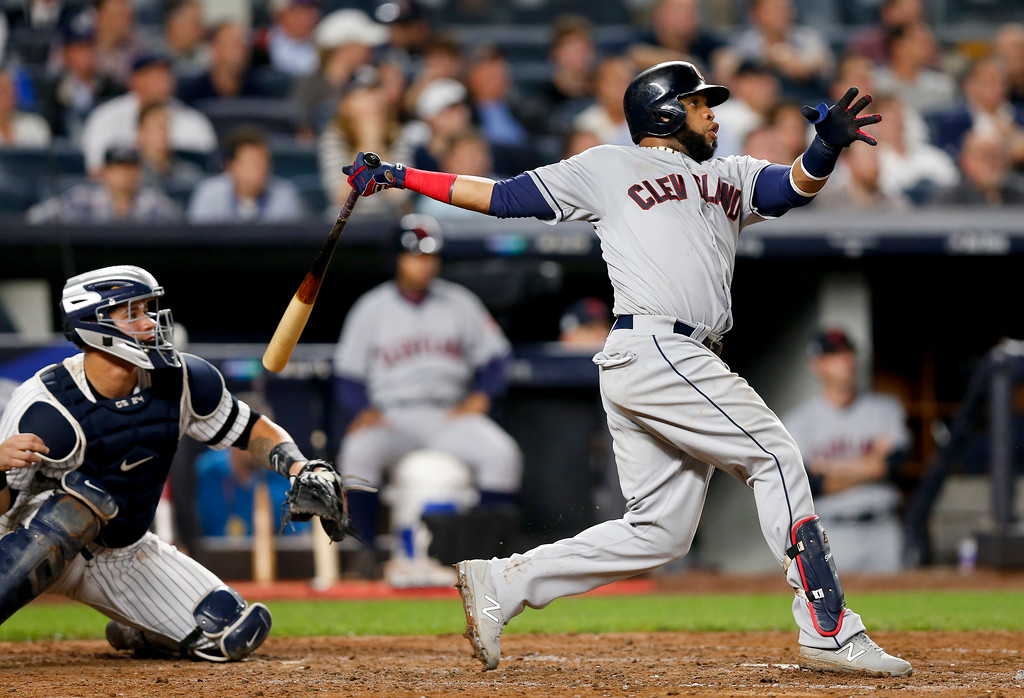 . Cleveland Indians\' Carlos Santana (41) connects for a two-run home run against the New York Yankees during the fourth inning in Game 4 of baseball\'s American League Division Series, Monday, Oct. 9, 2017, in New York. (AP Photo/Kathy Willens)
