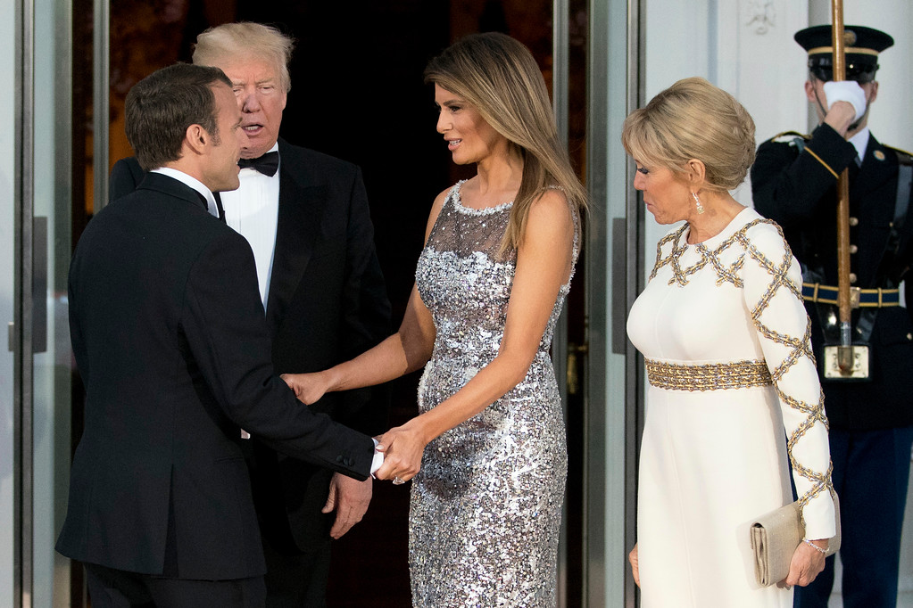 . President Donald Trump and first lady Melania Trump greet French President Emmanuel Macron and his wife Brigitte Macron as they arrive for a State Dinner at the White House in Washington, Tuesday, April 24, 2018. (AP Photo/Andrew Harnik)