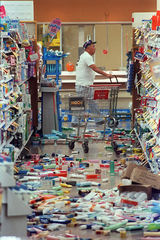 . Food items litter the floor in an aisle at a Safeway food store in south San Francisco shortly after an earthquake  hit California on October 17, 1989. (GARY WEBER/AFP/Getty Images)