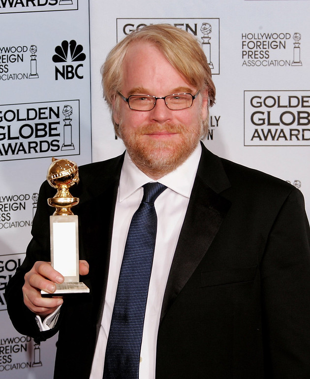 """. According to reports February 2, 2014, Philip Seymour Hoffman, 46, was found dead in his New York City apartment. Actor Philip Seymour Hoffman with his award for Best Actor, Drama for \""""Capote\"""" poses backstage during 63rd Annual Golden Globe Awards at the Beverly Hilton on January 16, 2006 in Beverly Hills, California.  (Photo by Kevin Winter/Getty Images)"""