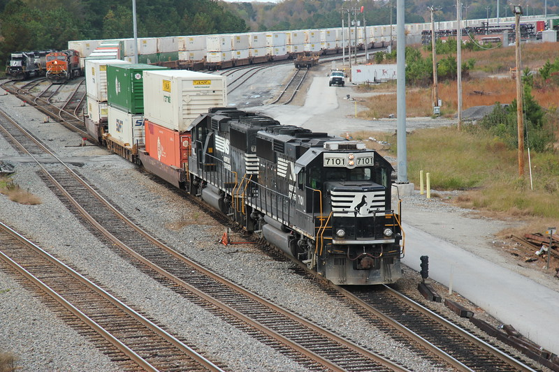 G90-06 [Whitaker Intermodal Local; Austell, GA]  NS 7101 (GP60) NS 7106 (GP60)  Switching domestic doublestacks at Whitaker Yard to Runaround at NS England, Whitaker Yard, Austell, GA.