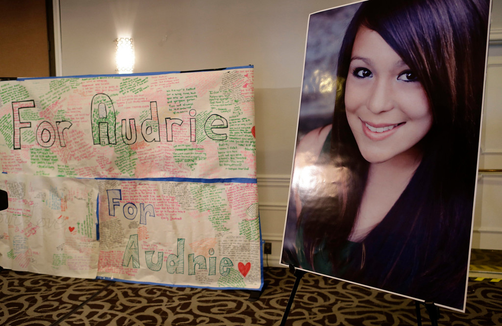 . A large poster and photograph of Audrie Pott are displayed at a news conference in San Jose, Calif., on Monday, April 15, 2013. Saratoga High School student Audrie Pott,15, committed suicide last September following an alleged sexual assault by three 16-year-old classmates. Photos of the assault were shared publicly prompting her to take her own life eight days later. (Gary Reyes/Bay Area News Group)